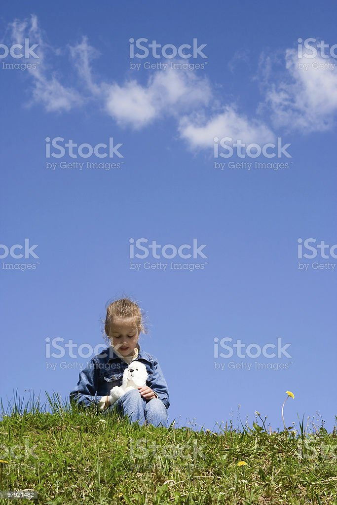 girl playing with a toy dog royalty-free stock photo