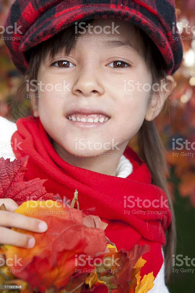 Girl playing with autumn leaves royalty-free stock photo