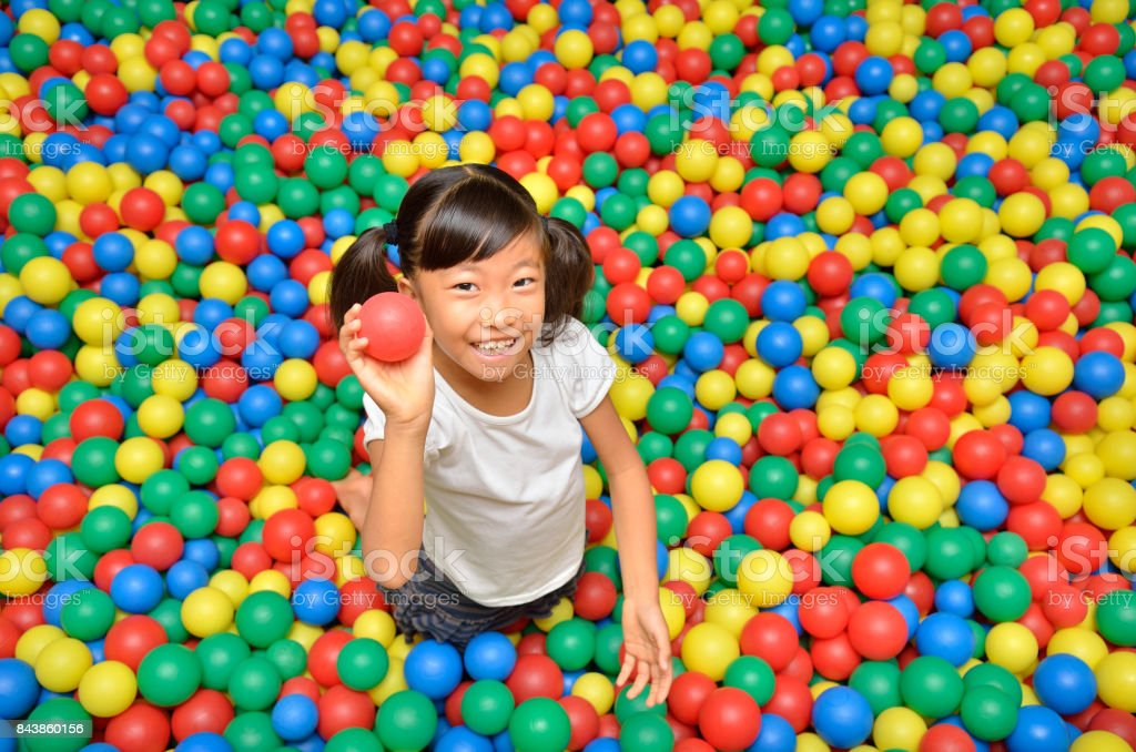 Girl playing with ball stock photo