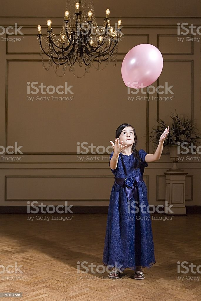 Girl playing with balloon 免版稅 stock photo