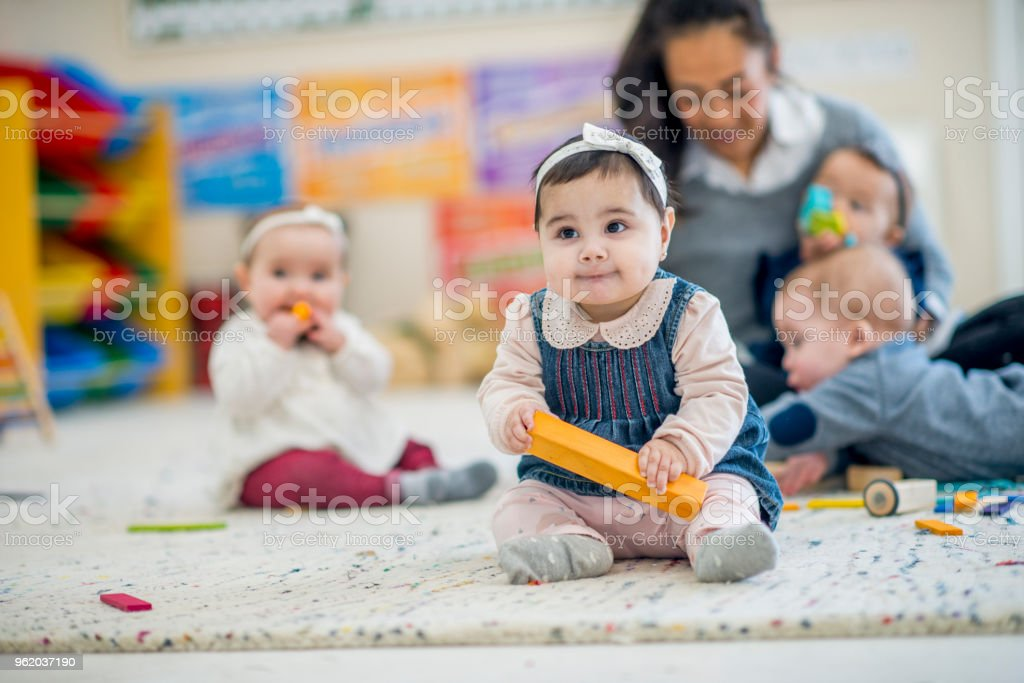 Girl Playing With Block stock photo