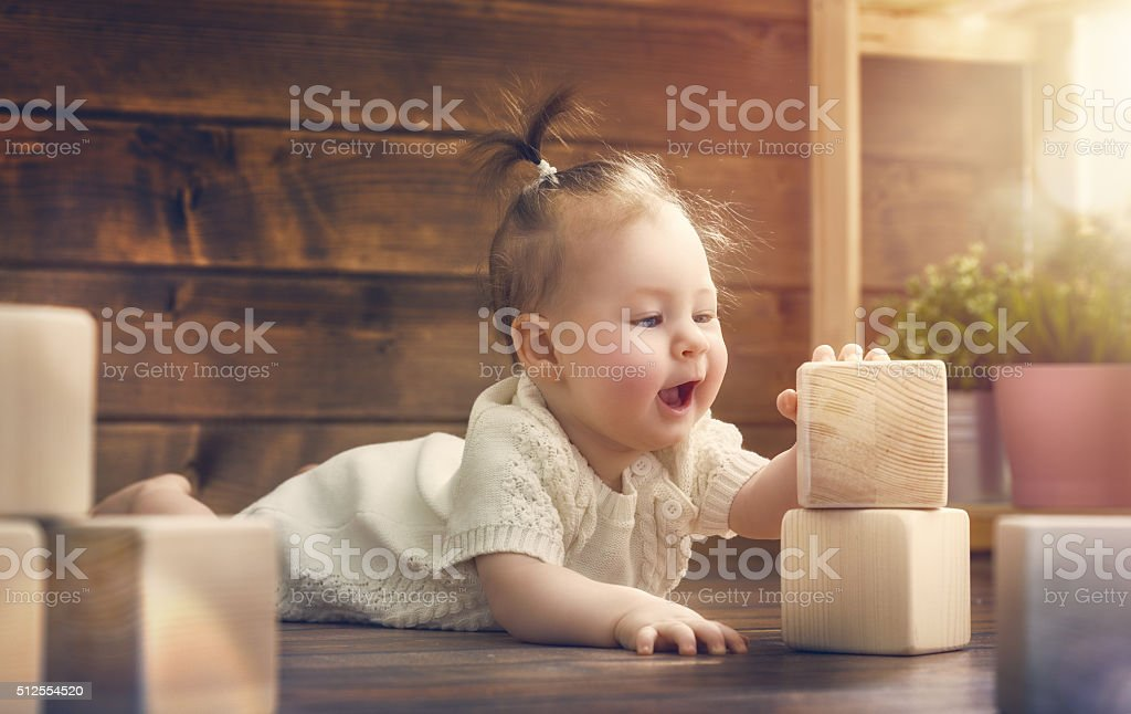 girl playing with blocks stock photo