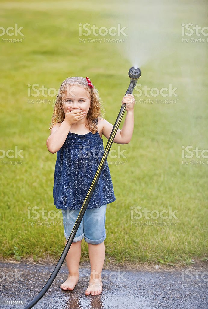 Girl Playing With Garden Hose royalty-free stock photo