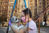Close up of girl playing with her dog on the playground
