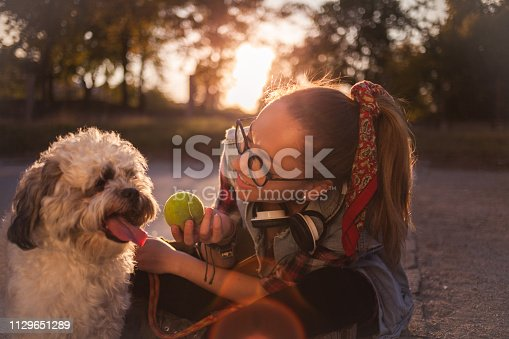 istock Girl playing with her dog 1129651289