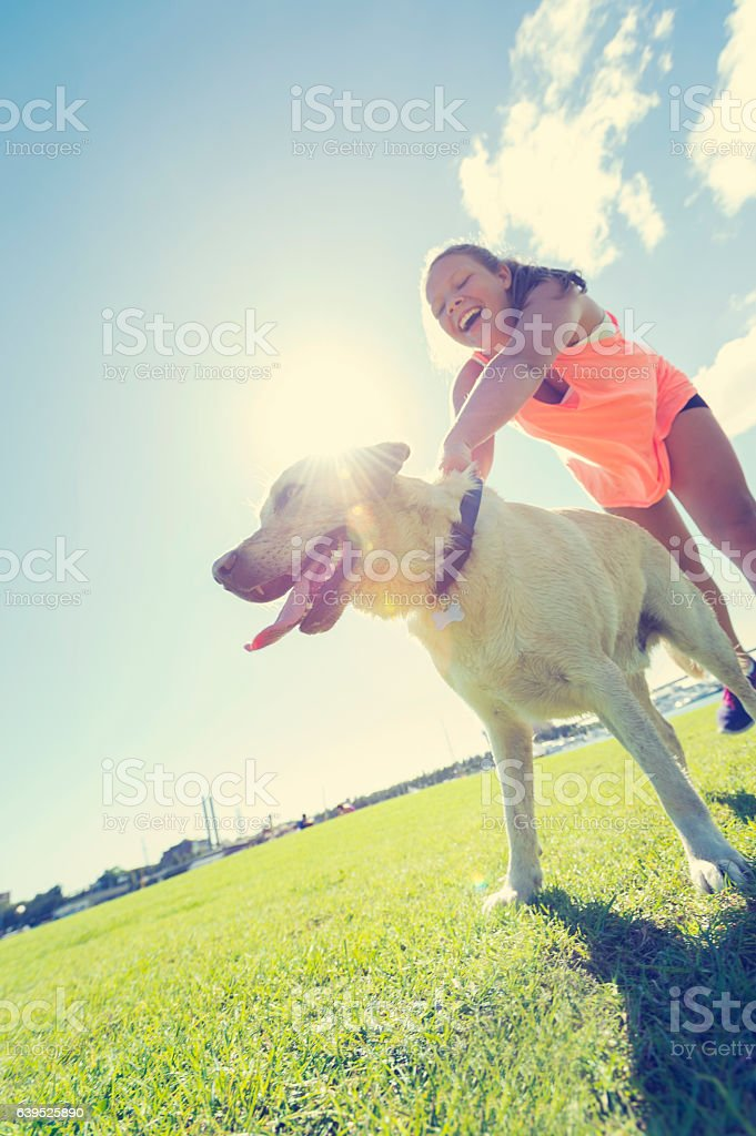 Girl playing with her dog stock photo