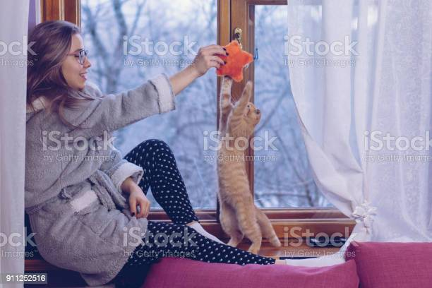 Girl playing with kitten picture id911252516?b=1&k=6&m=911252516&s=612x612&h=72vadzjukie 342i7izewvd8zjjgniqezlkeflgjdyc=