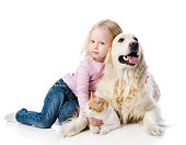 istock girl playing with pets - dog and cat. 525038256