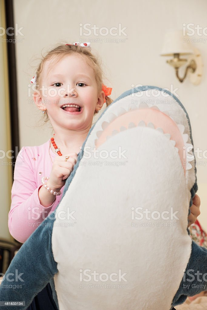 Girl Playing with Plush Toy stock photo