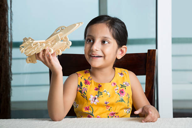 Girl playing with toy airplane - Stock image stock photo