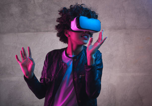 A girl playing with VR headset stock photo