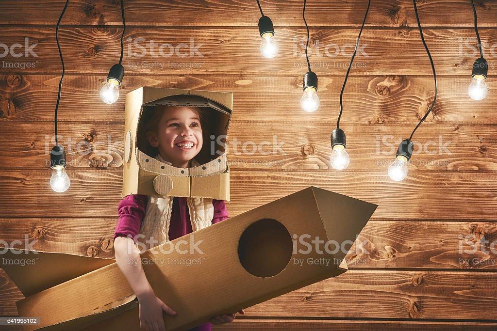 girl plays astronaut stock photo
