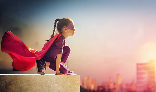 girl plays superhero - dreamlike stock photos and pictures