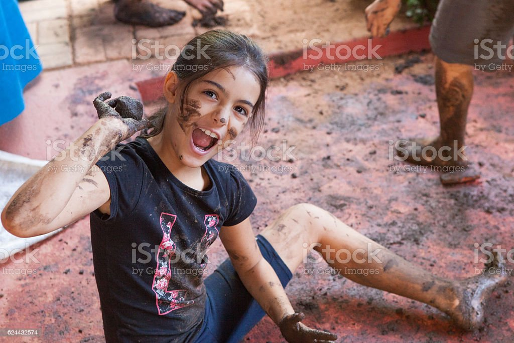 Girl plays with mud stock photo