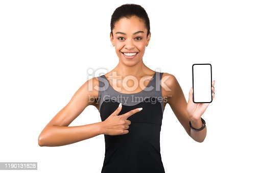 1132512759 istock photo Girl Pointing Finger At Smartphone Blank Screen Standing, White Background 1190131828
