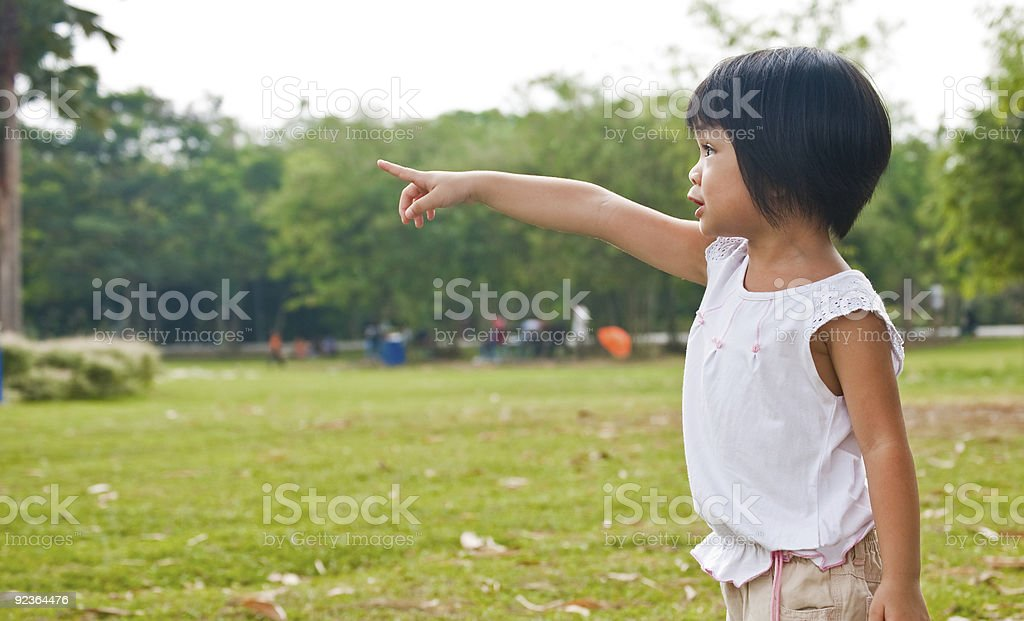 Girl pointing to something royalty-free stock photo