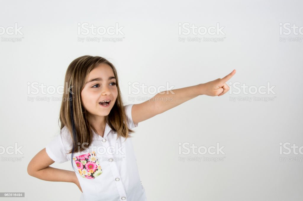 Girl pointing up - Royalty-free 2016 Stock Photo