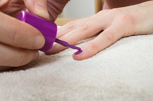 Girl polishing her nails