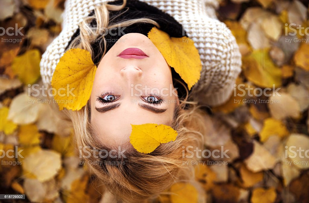 Girl portrait in leaves stock photo