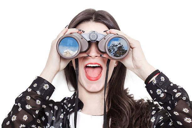 Girl portrait looking at mountains through binoculars - Photo