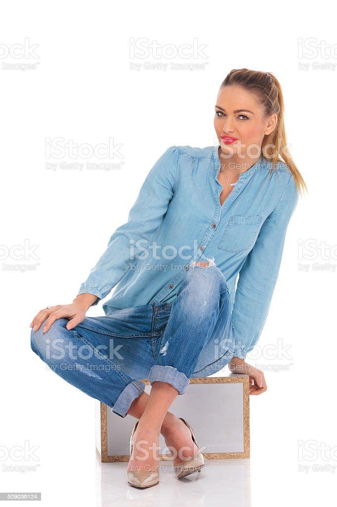 girl pose seated in studio stock photo