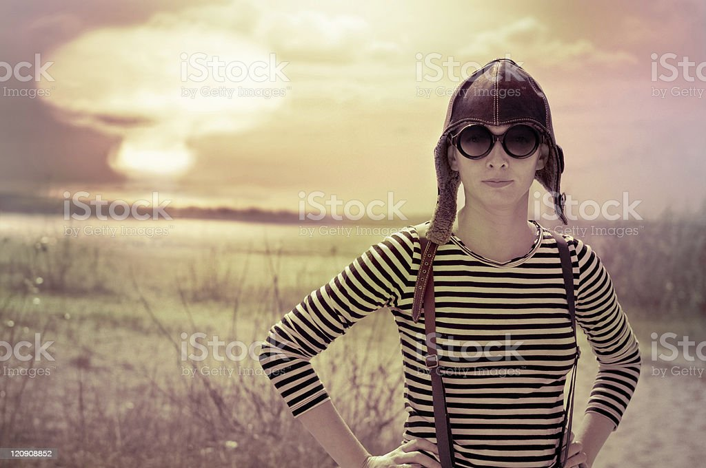Girl posing front of nuclear explosion stock photo