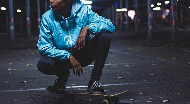 Girl posing on skateboard stock photo