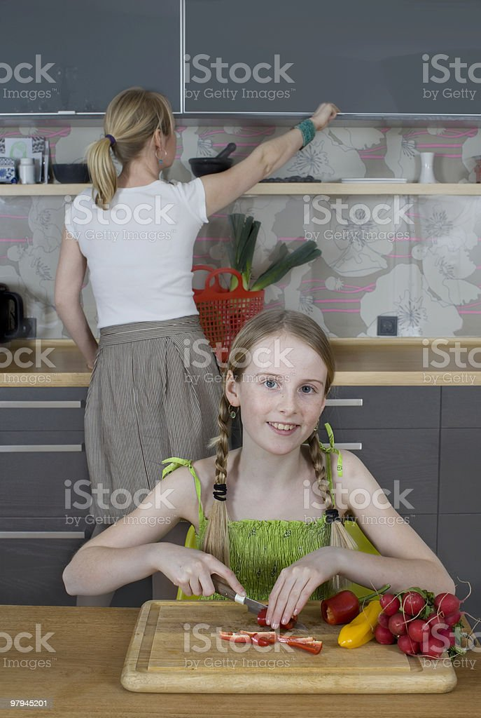 Girl posing while chopping vegetables royalty-free stock photo