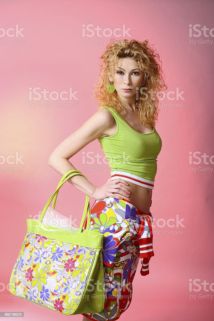 Girl posing with bag on red background stock photo