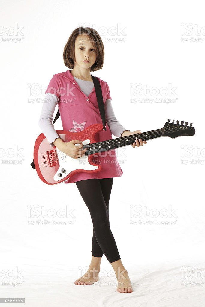 Girl posing with guitar royalty-free stock photo