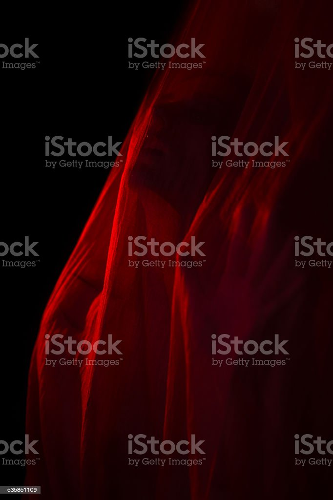 Girl posing with red fabric stock photo
