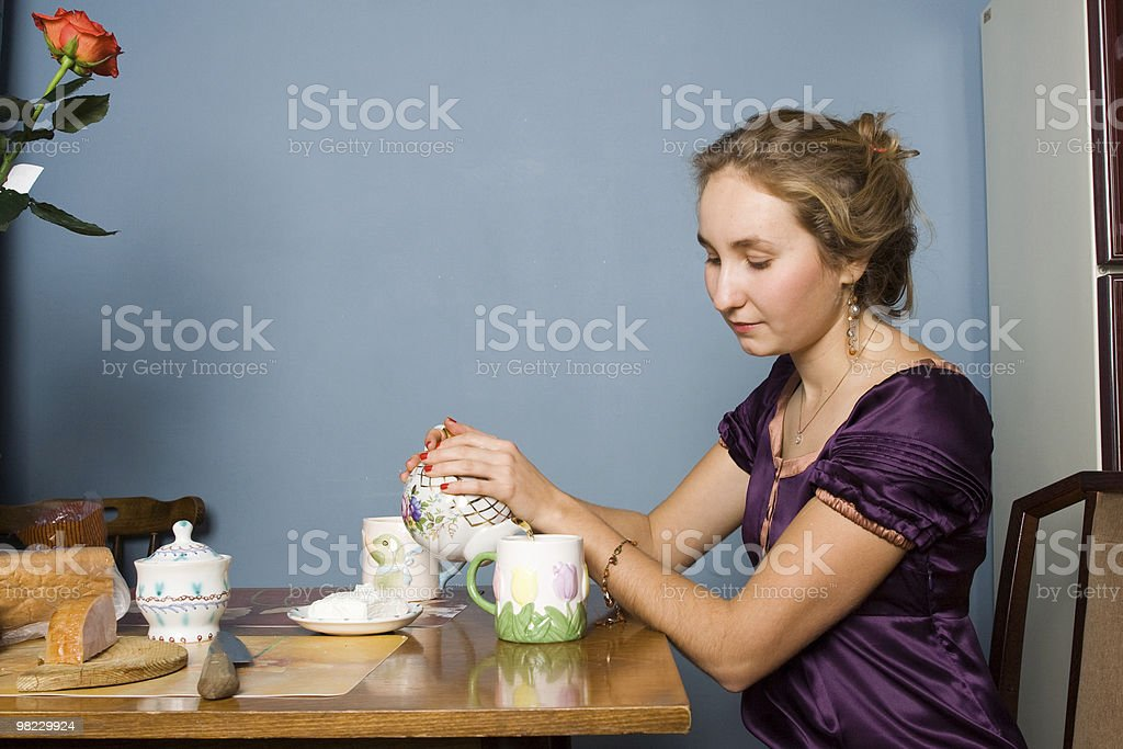 Girl pouring a cup of tea royalty-free stock photo