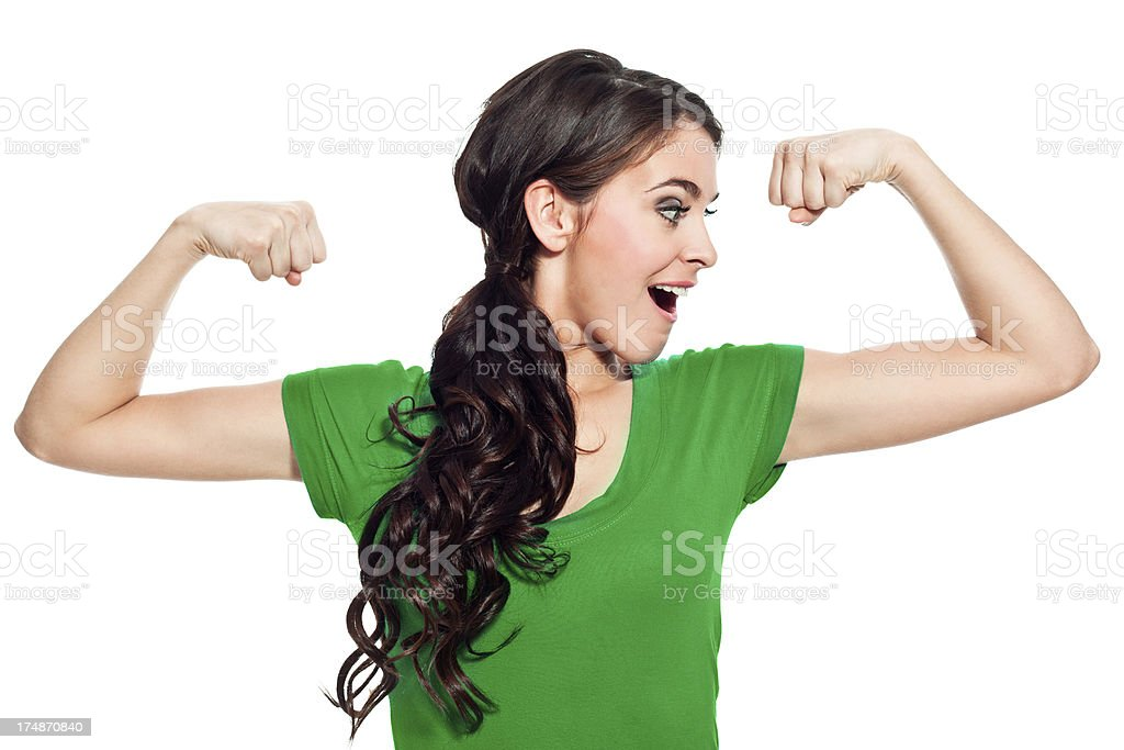 Girl power Portrait of cute young woman with raised arms, flexing her muscles.  20-24 Years Stock Photo