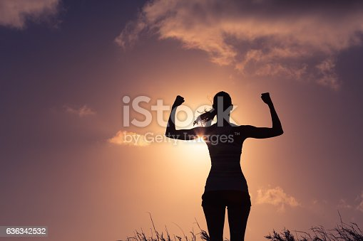 Strong and confident woman flexing her muscles. Achievement concept.