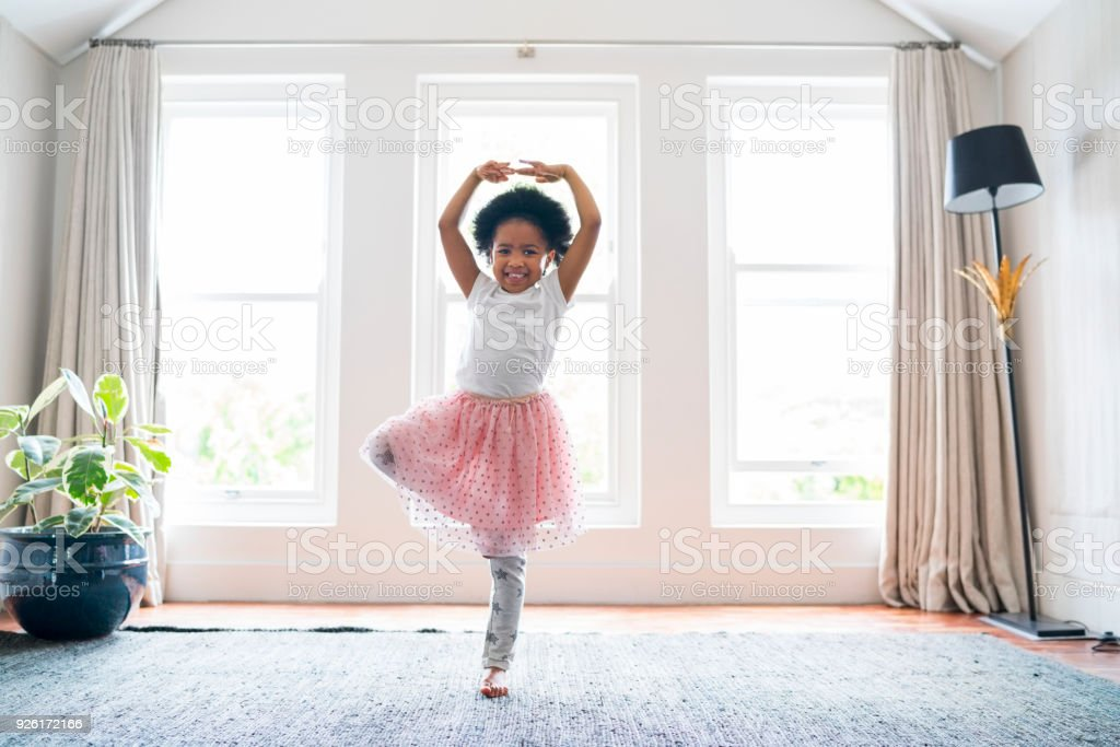 Girl practicing ballet dance at home stock photo