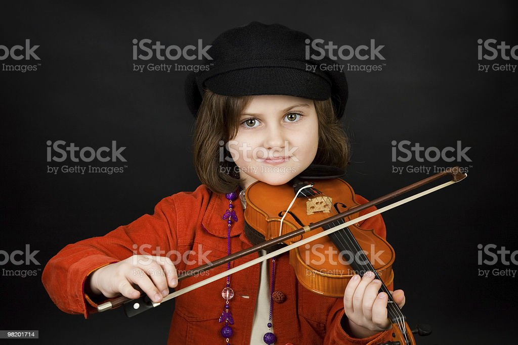 Girl practicing the violin royalty-free stock photo