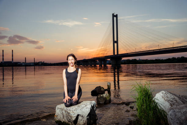 girl practicing yoga on the background of the city - downtown stock photos and pictures
