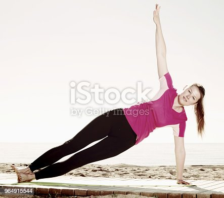 Girl Practicing Yoga Poses On Beach Stock Photo & More Pictures of Activity