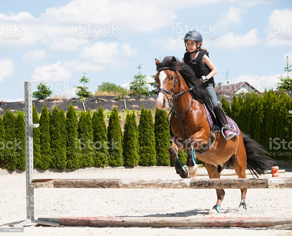 Girl practising horse riding stock photo