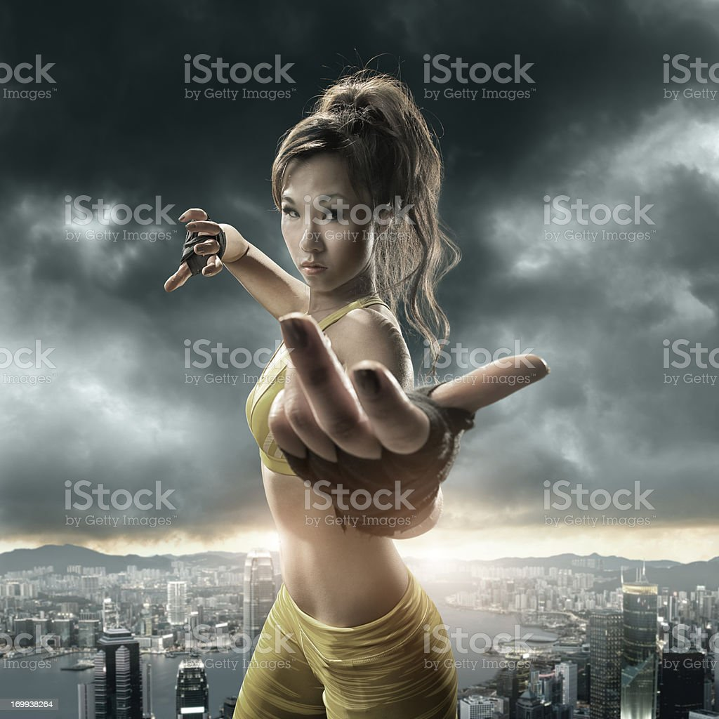 Girl Practising Martial Arts above Cityscape royalty-free stock photo