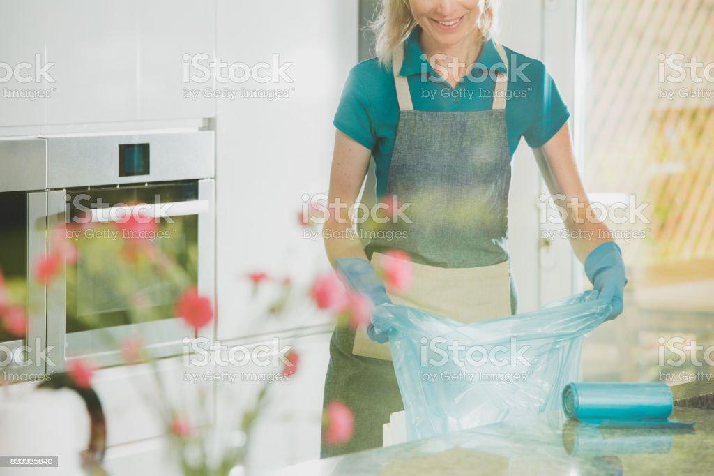 Girl prepares garbage bags stock photo