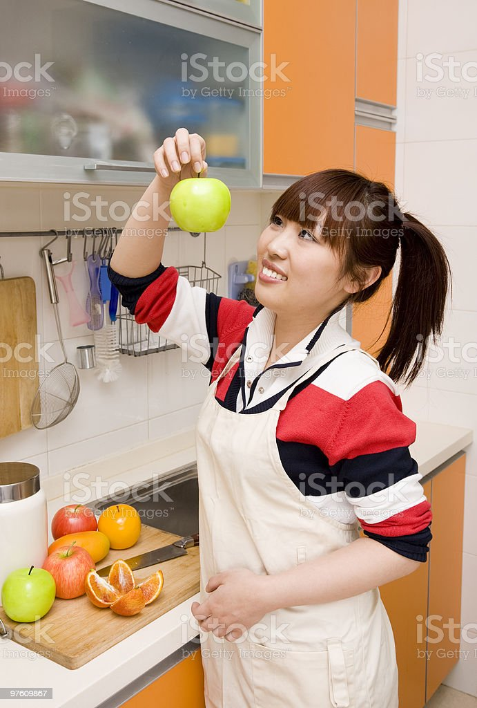 girl preparing fruit in the kitchen royalty-free stock photo