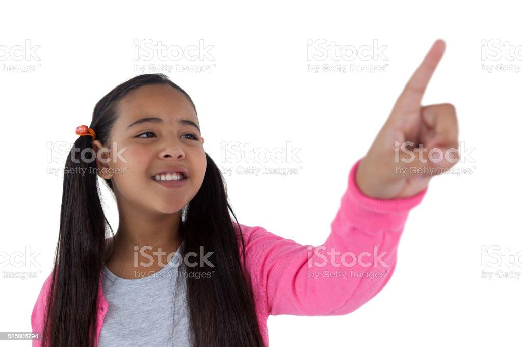 Girl pressing an invisible virtual screen stock photo
