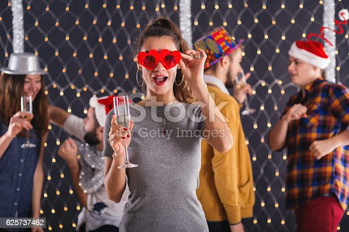 865399512istockphoto Girl proposing a toast 625737462