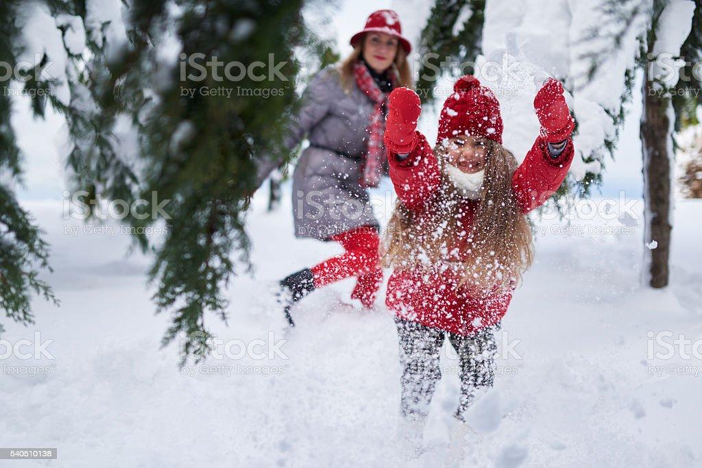 girl provokes play   snow stock photo