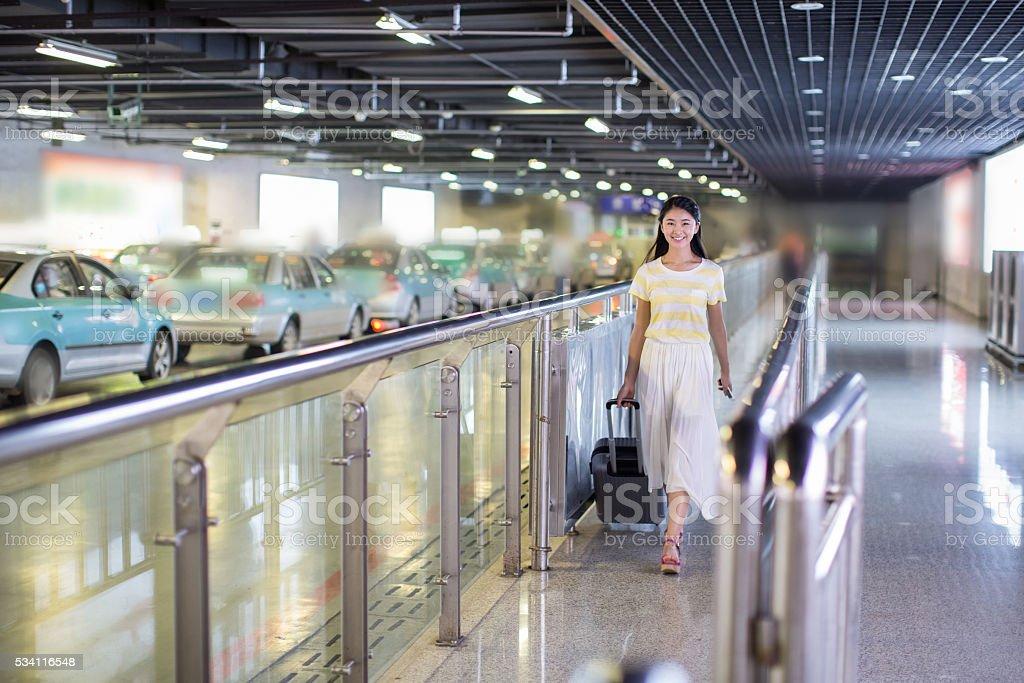 girl pulling suitcase stock photo