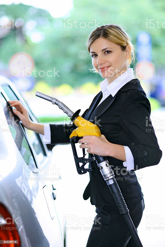 Girl pumping gas in gas-station. royalty-free stock photo