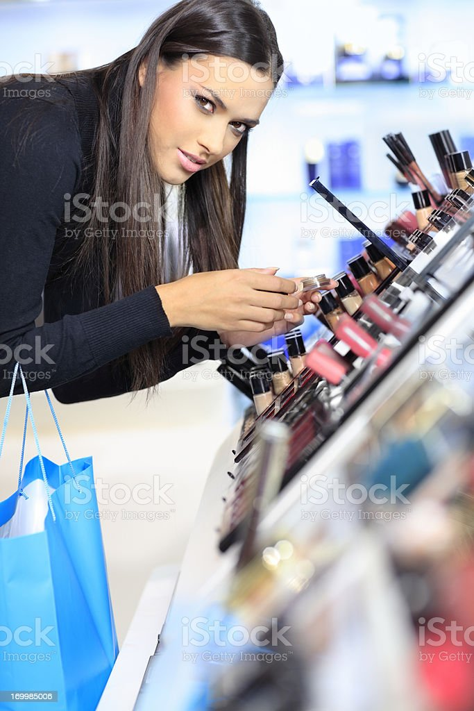 Girl  purchases cosmetics in the beauty shop stock photo