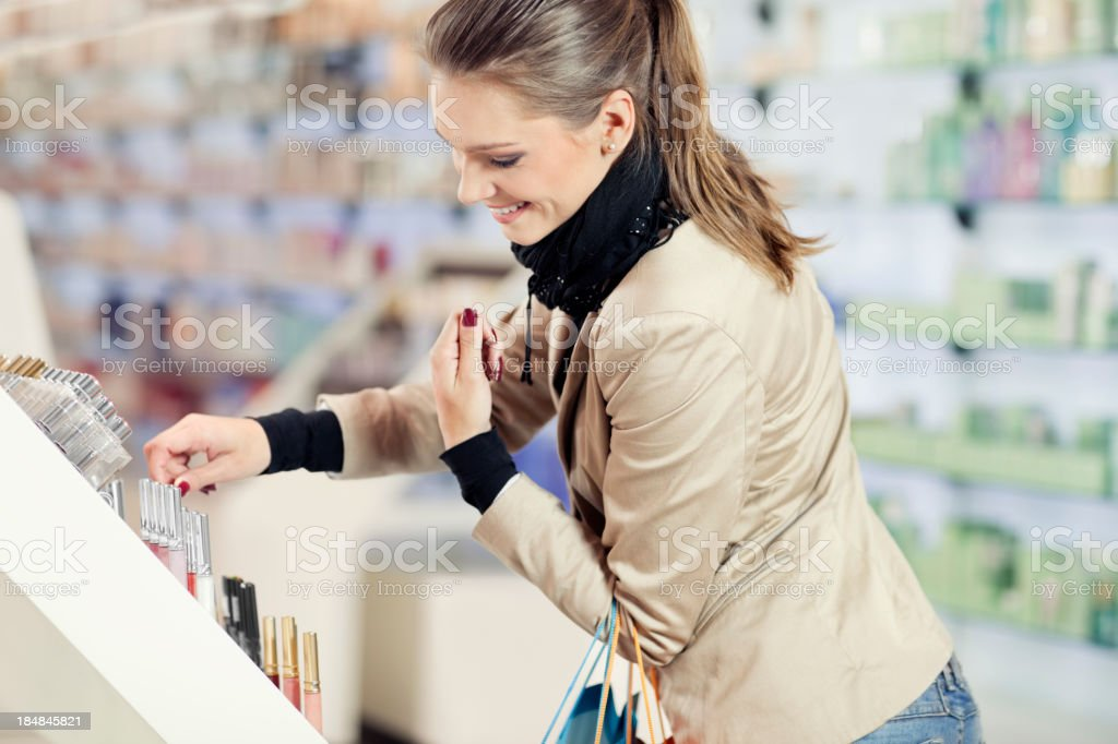 Girl  purchases cosmetics in the beauty shop royalty-free stock photo