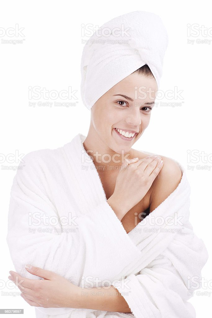 Girl putting cream on her shoulder royalty-free stock photo